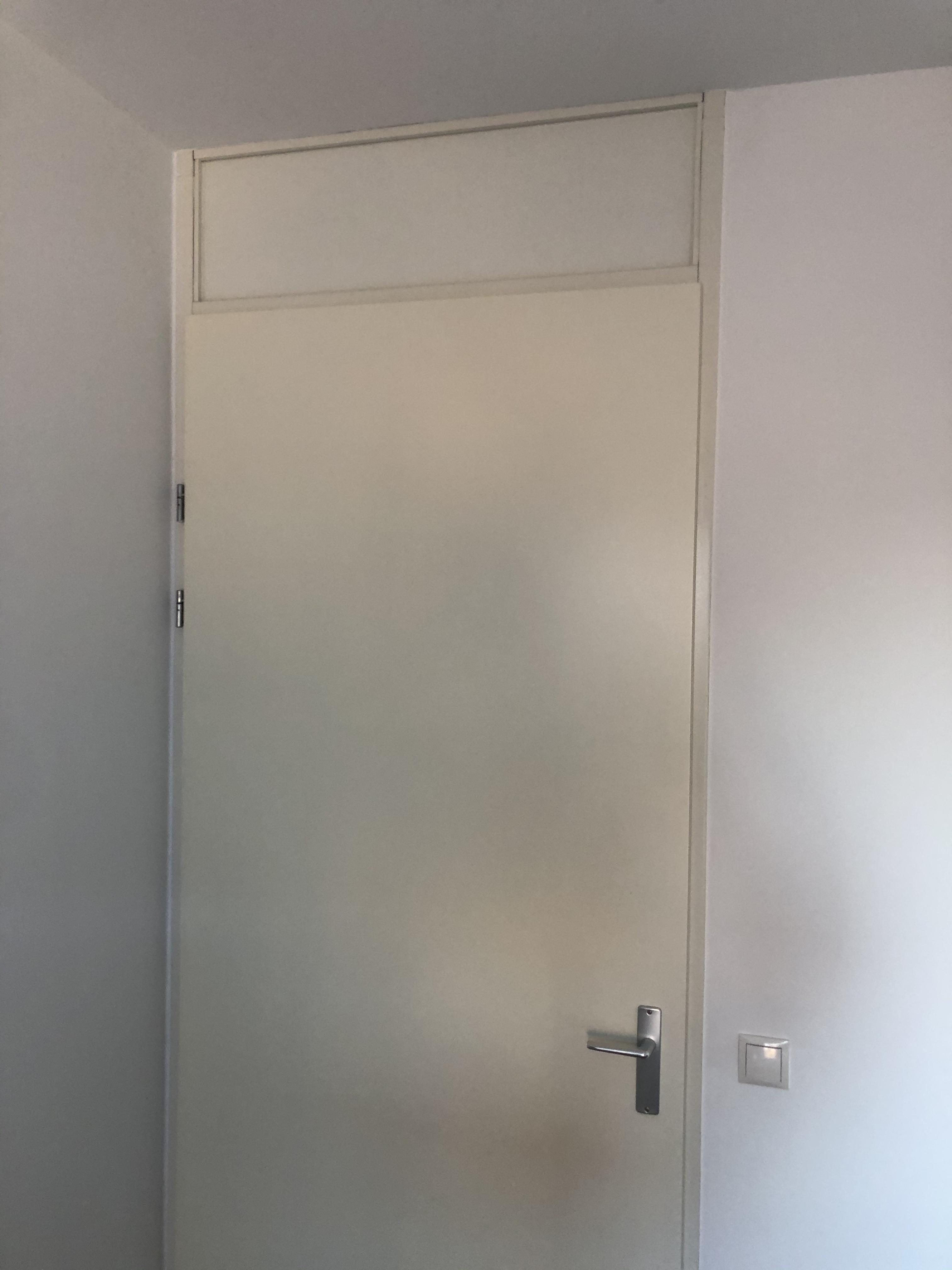 Bovenlicht deur dicht gemaakt met HPL